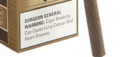 detail of surgeon general's warning on black & mild packaging