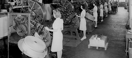 vintage photo of women working at machines in united states tobacco facility