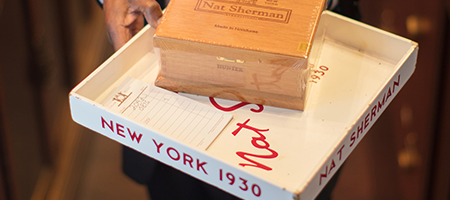Nat Sherman tray and cigar box being served by employee