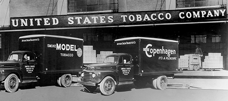vintage photo of delivery trucks at united states tobacco company