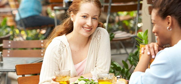 woman smiling in outdoor cafe